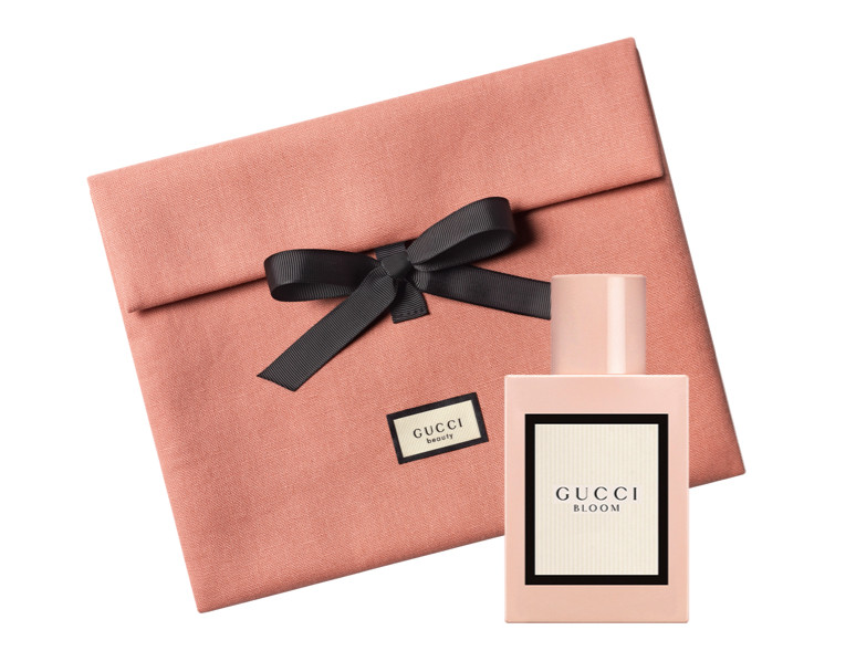 Receive a complimentary 2 piece Gucci  gift with any large Gucci Guilty Men's or Women's Collection purchase.